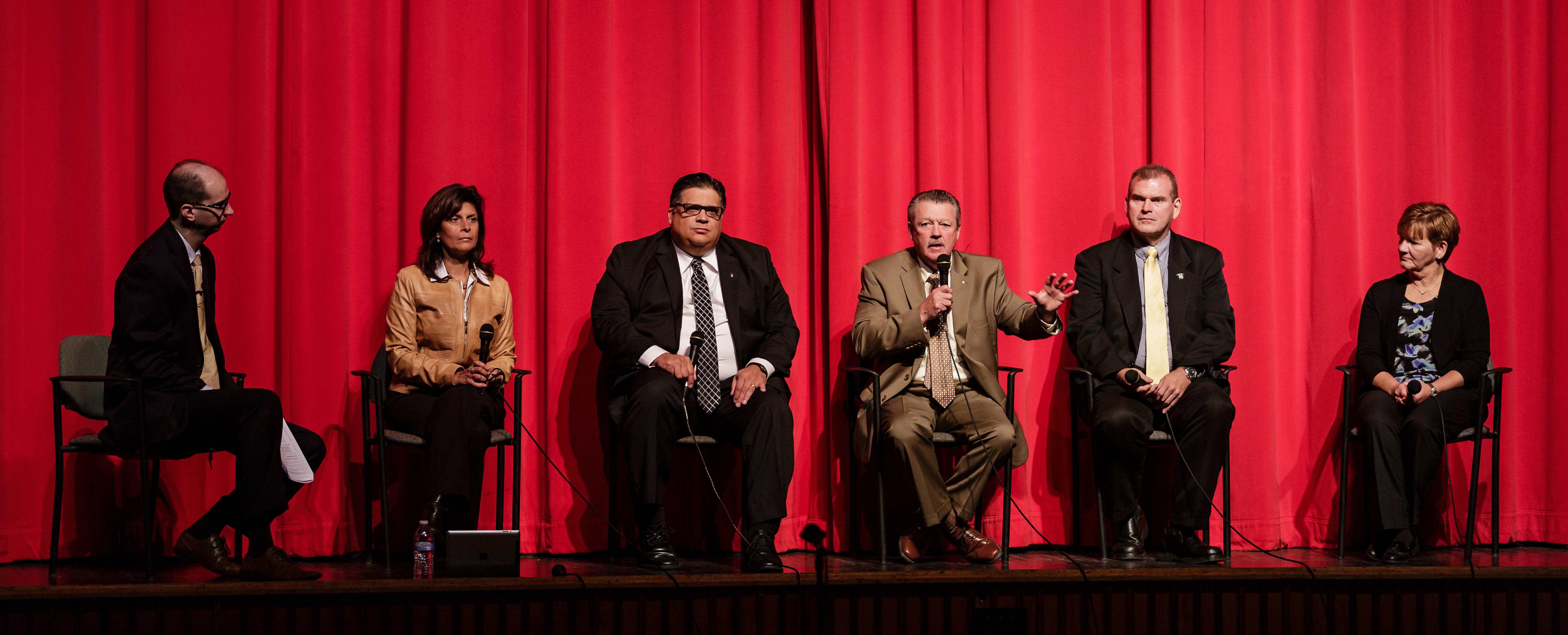 Mark Despotakis talks with McKeesport Superintendent, Dr. Rula Skezas; State Representative Marc Gergely; State Senator Jim Brewster; PMEA President, Dennis Emert; and McKeesport High School Band Director, Karen Cole.